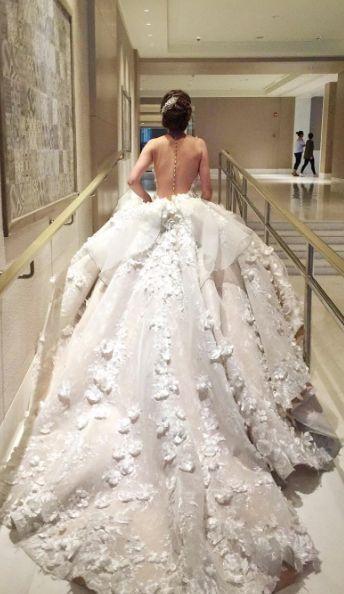 Sleeveless illusion bodice white ballgown wedding dress; Featured Dress: Mak Tumang