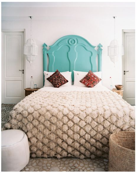 Moroccan home with turquoise headboard