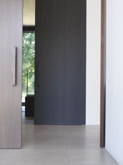 Love flush wood pivot doors simple and timeless
