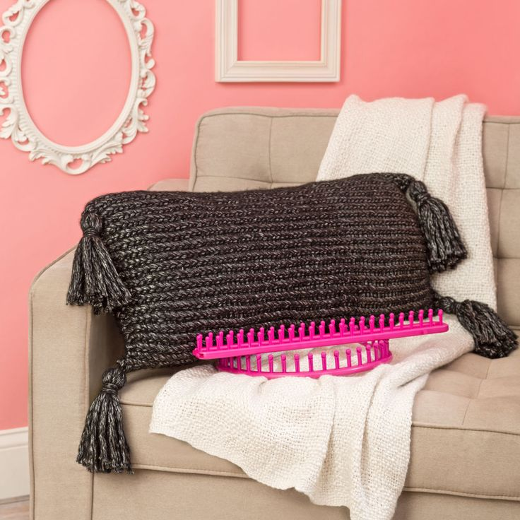"""This pretty loom knit tasseled pillow can either be made flat or in-the-round. What a great home accent! <p style=""""text-align:center""""><img alt="""""""" src=""""http://demandware.edgesuite.net/aawa_prd/on/demandware.static/-/Sites-simplicity-project-master/default/dw79368827/images/project/Project-Ratings_Yarn-Weights/Easy.jpg"""" title="""""""" /></p>"""