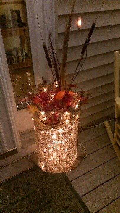 All you need is a burlap sac, Xmas lights, chicken wire, and fake leaves :)