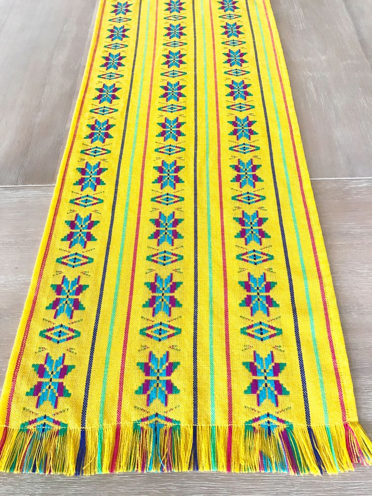 A personal favorite from my Etsy shop https://www.etsy.com/listing/539832798/mexican-tablecloth-runner-or-napkins