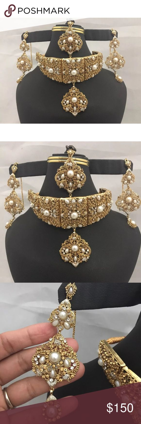 NWOT Indian Bollywood jewelry set NWOT Indian latest bridal two Toned silver / golden Polki Jaraao choker style jewelry set . Include choker attached with rope to make loose or tight .Long earrings and matha Tikka Set attached with rhinestones, and Pearl Beads Extremely beautiful in front .pictures are not doing justice.  All sales are final no return or exchange accepted. Thank you Jewelry Necklaces