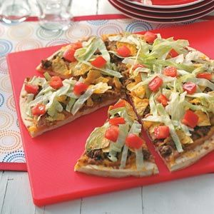 Taco Pizza--Convenient prebaked crust makes this tasty taco pizza as easy as can be.
