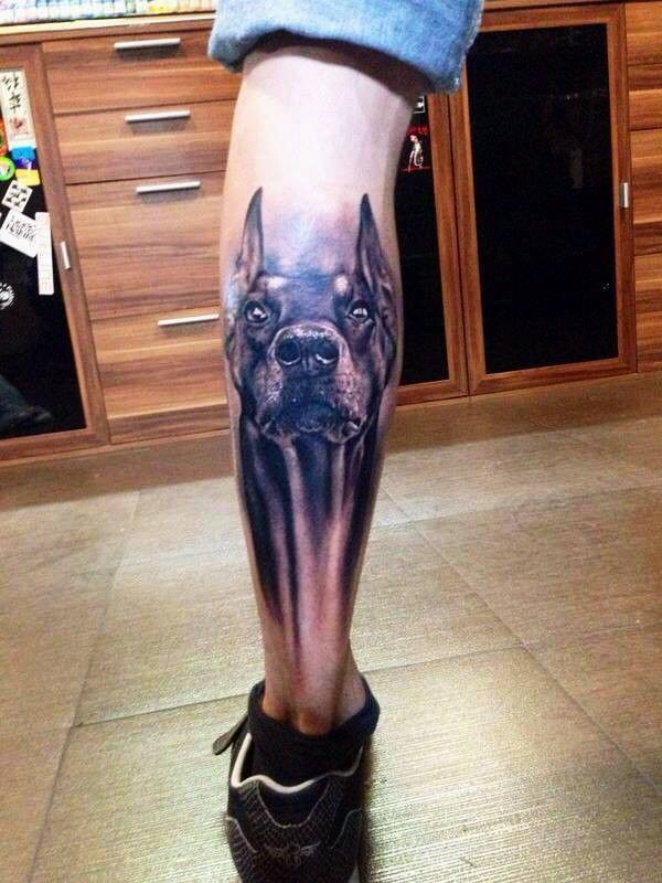 Black-ink doberman dog tattoo for men on shin