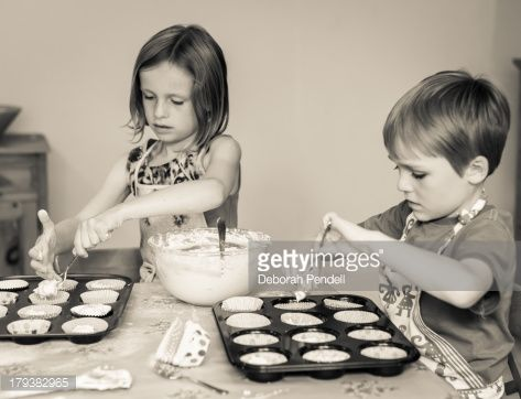 Stock Photo : Young boy and girl make cakes