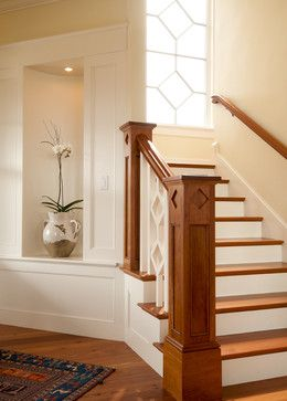 Cedar Bluff - Craftsman Style Staircase- - Boston - Siemasko + Verbridge the diamond detail is repeated in the fretwork of the spindle and the panes Simplicity. Clean lines and simple silhouettes are key with this design approach Molding around niche, stair rail Handrail Like the nook I like the wood white contrast Cubby for plant, with light