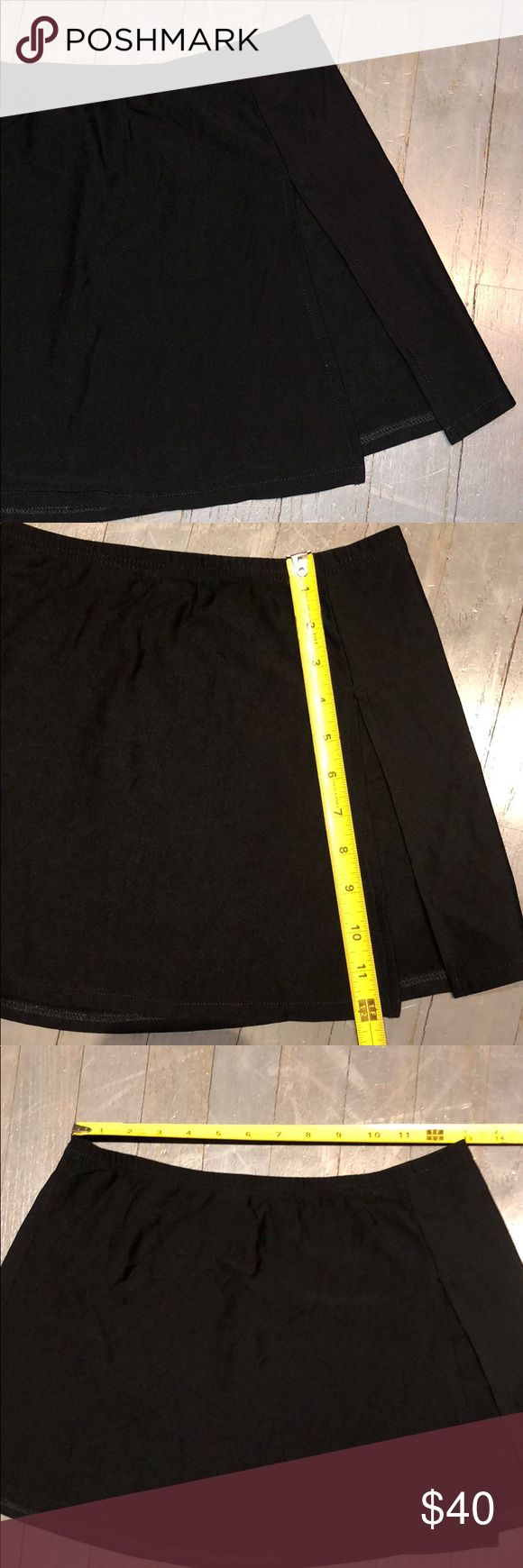Calvin Klein Side Slit Swim Coverup Mini Skirt Calvin Klein Swimwear Black Side Slit Swim Coverup Skirt Saromg. Measurements in pictures. 89% Tactel Nylon 11% Lycra Spandex RN 75585 Made in USA Calvin Klein Swim Sarongs