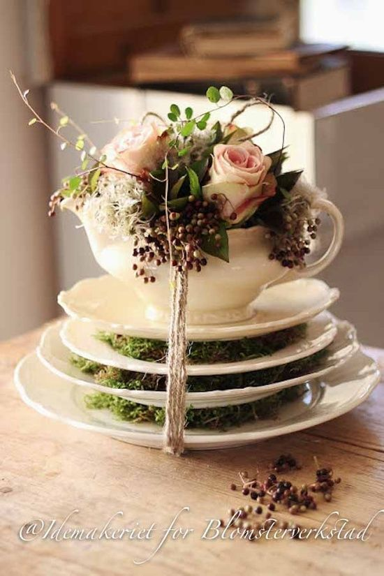 Cup as a vase...Love the moss. Good centerpiece for a tea party.