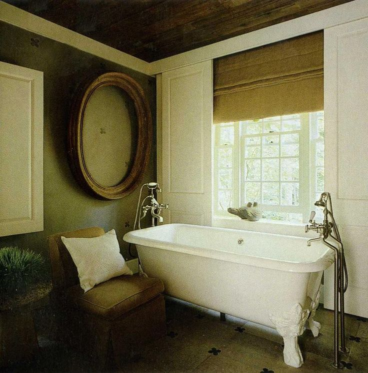 A Clawfoot Tub...love The Oval, Empty Frame Too.