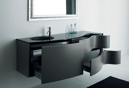 Bathroom furniture design an attraction that is not inherent in a house. Here is a cabinet for the bathroom with an elegant black color – Max from Novello. Black furniture with black sink looks amazing and can decorate any modern bathroom design.