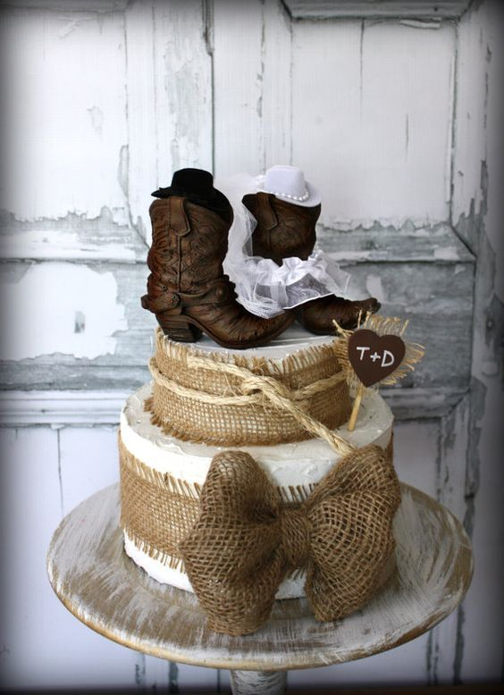 country western rustic cowboy boots wedding cake topper / http://www.deerpearlflowers.com/cowgirl-boots-fall-wedding-ideas/2/