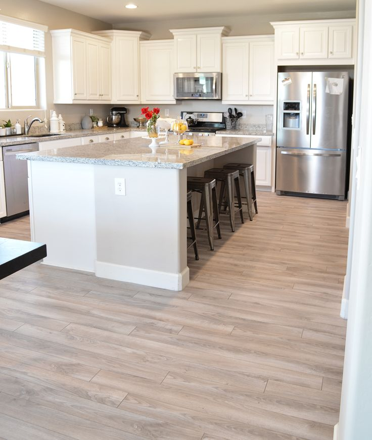 White cabinets, light counters, stainless appliances