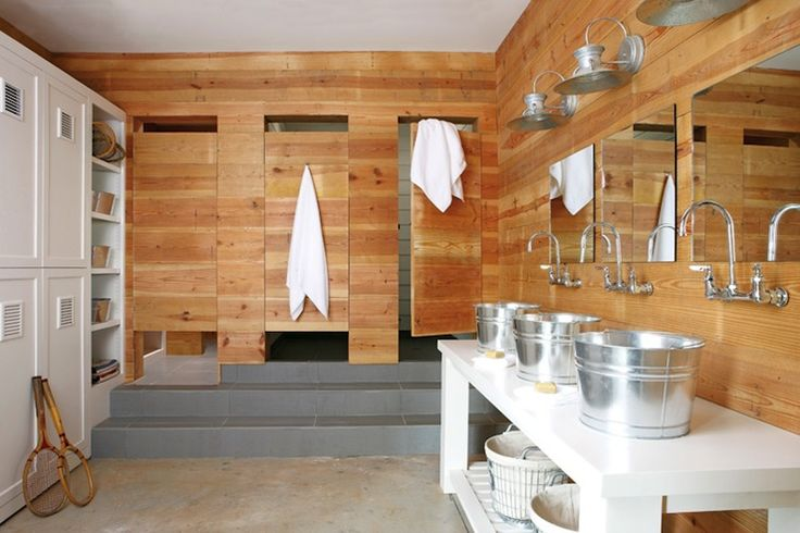 Camp Style community bathroom with locker room like storage built by Bell Custom cabinetry, bucket sinks, polished nickel wall-mount faucets, barn light sconces and numbered wire hamper baskets with canas lining.