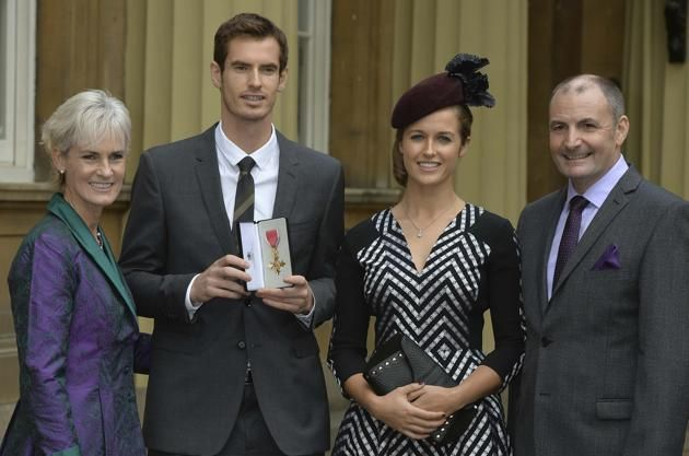 Still recovering from recent surgery, Andy Murray took some time away from rehab to receive his Order of the British Empire (OBE) Medal from Prince William during an Investiture ceremony at Buckingham Palace on Thursday. It was a family affair as Andy posed with his parents, Mum & Dad, Judy and Will Murray, girlfriend Kim Sears and his new OBE Medal. 10/17/13