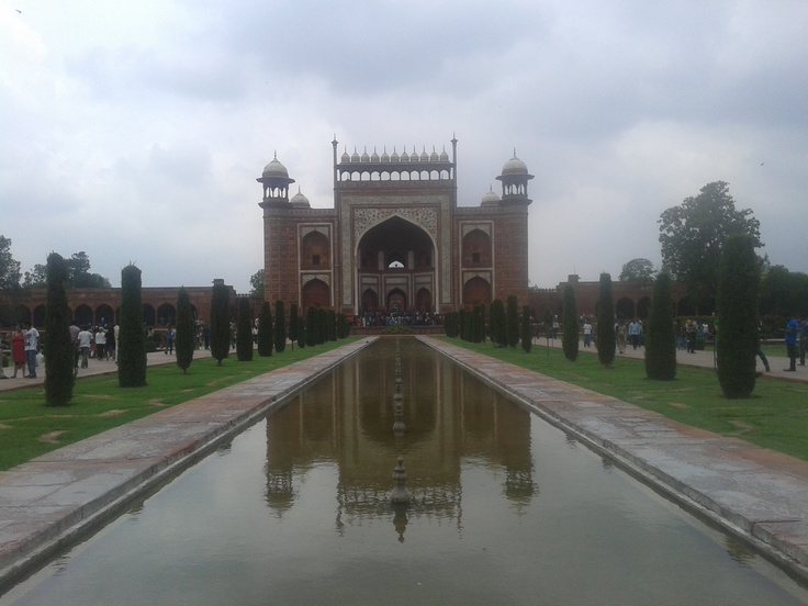 Symmetric shot of Great gate (Darwaza-i rauza), main entrance to The Taj Mahal.