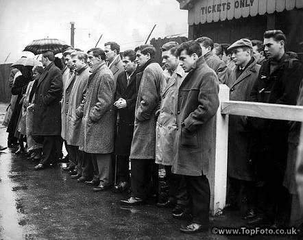 25 February 1958Survivors of the Munich air crash watch Matt Busby unveil a memorial to those who died. In the centre, hands in his pockets, Dennis Viollet. Behind him, Harry Gregg and next to him Albert Scanlon and next to Scanlon is Ken Morgans. 25th February 1960