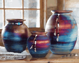 Southwestern Spirit Jars - Shown in all 3 sizes - Vivid, dreamlike southwest colors are adorned with turquoise stones, beads and feathers on the handmade raku ceramic Southwestern Spirit Jars by artist Jeremy Diller. Each piece is unique and size may vary. ~