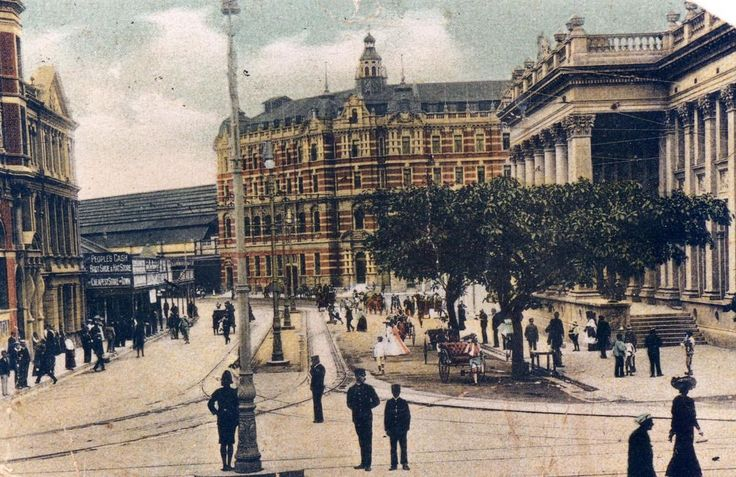 c1910 Intersection of West Street & Gardiner Street in Durban. Post Office on the right, railway station far background. Caleb Winterburn, in police uniform, to right of light pole