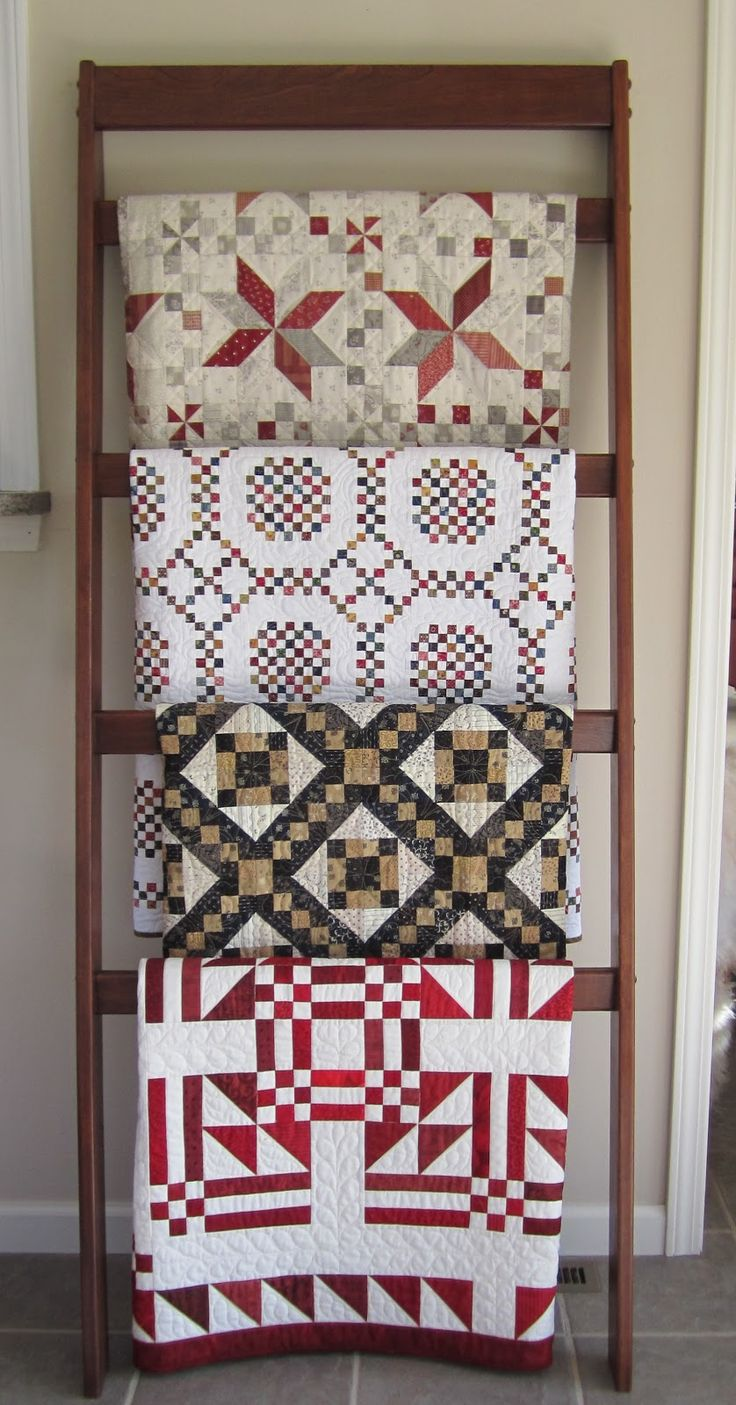 Love the quilt rack! The bottom quilt is Father's Fancy from a pattern in Judy Martin's book, Scraps.