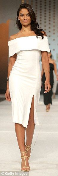 Australia time to start shopping! Crispy white: Shanina Shaik rocked a classic look, wearing a strapless dress on the Kookai runway