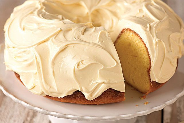 Discover this Luscious Lemon Pound Cake with tart lemon curd frosting. Learn why the world loves lemons when you prepare this delicious recipe today!