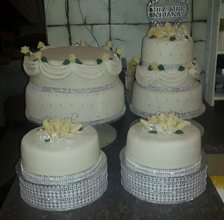 Wedding cake with multiple side cakes by Altefyn Cakes