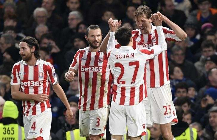 Britain Football Soccer - Chelsea v Stoke City - Premier League - Stamford Bridge - 31/12/16 Stoke City's Peter Crouch celebrates scoring their second goal Action Images via Reuters / Tony O'Brien Livepic
