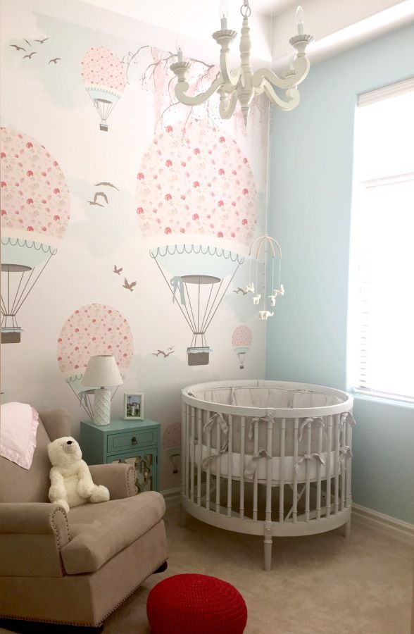 Adorable pink hot air balloon wallpaper nursery: http://www.stylemepretty.com/living/2016/10/02/a-hot-air-balloon-shower-thats-up-up-and-away-with-our-hearts/ Photography: Melissa Jill - http://www.melissajill.com/