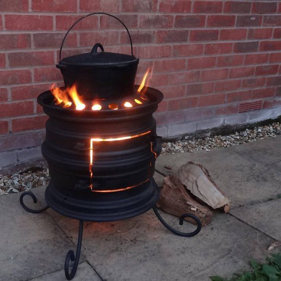 Wheel Rim Wood Burning Stove Upcycled Log Burner For Patio And Outdoors With Hand Forged Features Wood Burning Stove Log Burner Diy Wood Stove