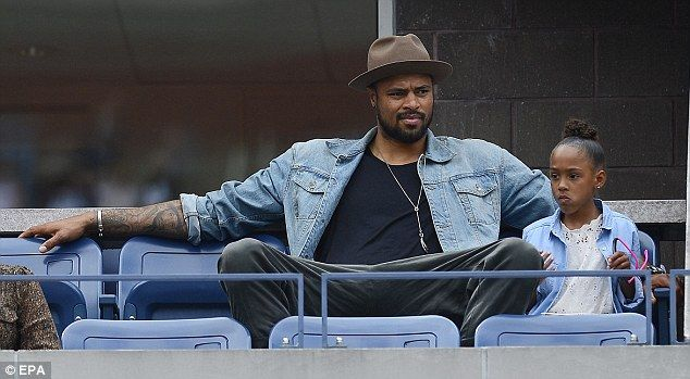 Enjoying it? US basketball star Tyson Chandler turned up to watch the match at Flushing Meadows