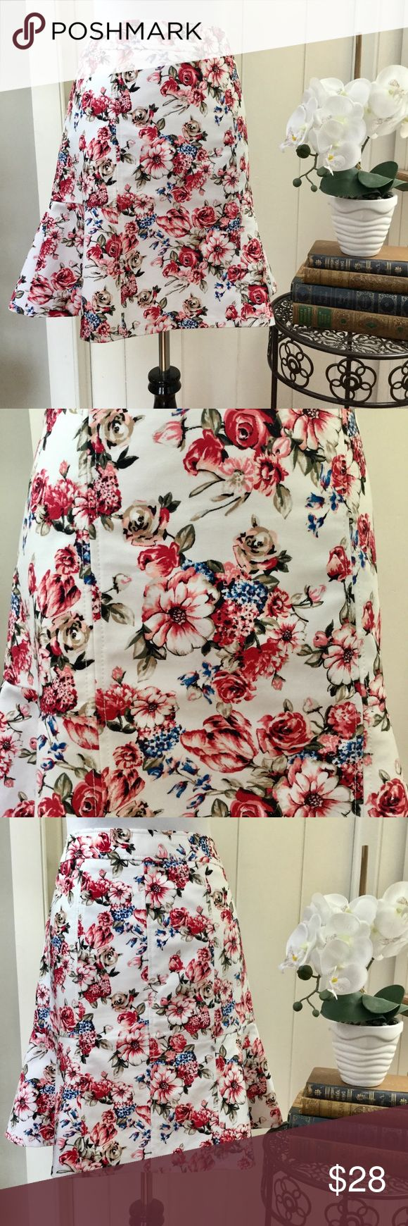 """WHBM Rose & White Floral Cotton Trumpet Skirt Gorgeous fully lined cotton and spandex trumpet skirt with a white, rose, green and blue floral print, flattering pleats and flowing hemline. Very figure flattering and fresh for spring. In excellent very lightly pre-loved condition with no holes, no spots, no rips, no defects. Waist 16.5"""", hips 19"""", length 20"""" with stretch. White House Black Market Skirts A-Line or Full"""