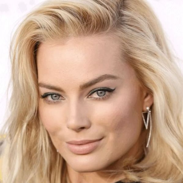 """Check out this #motykiemakovers on @margotrobbie. Voted """"sexiest woman of 2016"""" by FHM magazine. Beautiful to BE-AU-TI-FUL with this #motykiemorph ⚕️. ✅facial #fatgrafting ✅#rhinoplasty, and ✅ A touch of #juvederm. . . . . . . #drmotykie #plasticsurgeon #boardcertified #westhollywood #beverlyhills #90210 #plasticsurgery #stunner #details #margotrobbie #cameraangle #medical #dr #changeyourlife #subtle #enhancement #image #beauty #symmetry #bbl #brestaugmentation #coachella…"""