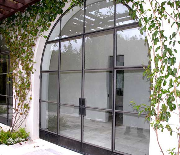 Arched double doors with operable casement window sidelites and fixed transom - Portella Custom Doors