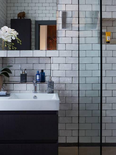 Baños de estilo ecléctico por REIS LONDON LTD