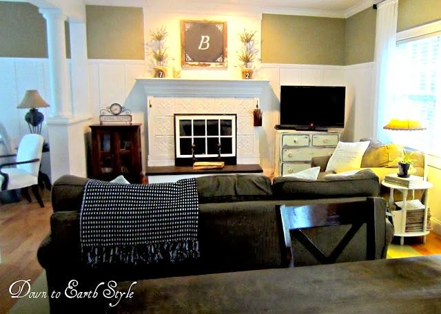 Fireplace is a way to have a bit of the look of those stoves I love so much - several good ideas in this house if colors were changed
