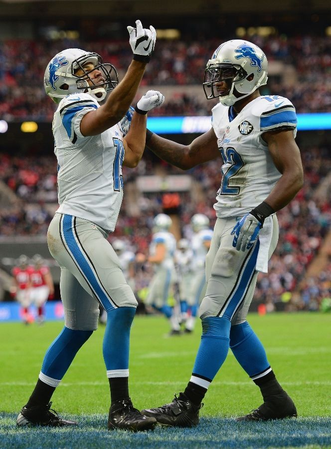 Golden Tate celebrates scoring a touchdown in the third quarter with Jeremy Ross, 10/26/2014