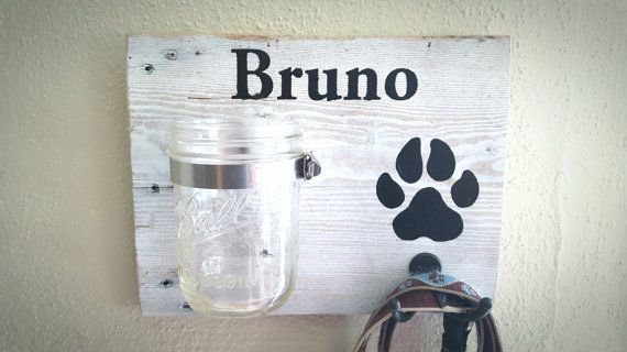 Perfect for the dog lover in your life! This rustic, personalized dog treat & leash holder features a wide mouth Mason jar for treats and a double