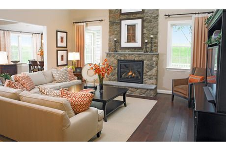 A Stone Fireplace Flanked By Windows Makes A Dramatic