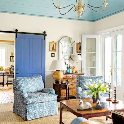 The Art of Living Small: Living Room with Blue Barn Door