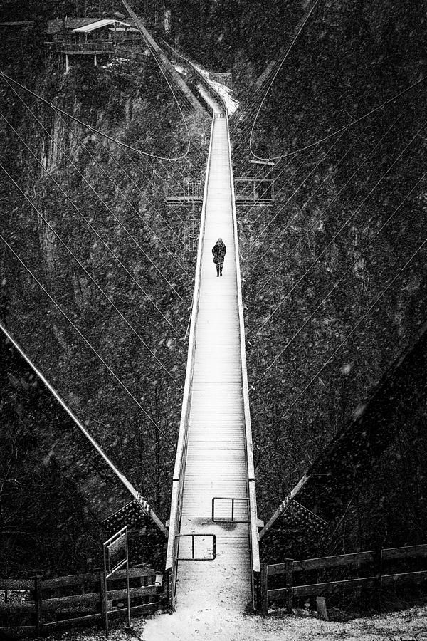 Hanging bridge in winter with snow, black and white fine art photography with stark contrast. Benni Raich Brücke, Pitztal, Austria, Europe. View from above. Available as poster, framed fine art print or canvas print. (c) Matthias Hauser hauserfoto.com
