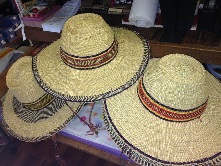 Elephant grass hats.  Reshape to your head by dunking them in water and wearing.  These last for ages ... and then oneday they'll make great compost!