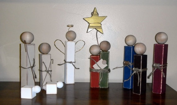 Simple wood nativity set using 2x2 wood and wooden knobs.