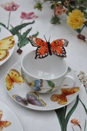 I just like this so much- so refreshing butterfly perched on teacup for garden party