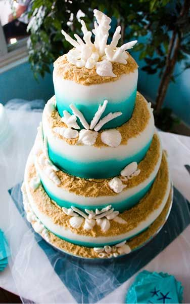 Almost too pretty to eat beach wedding cake.
