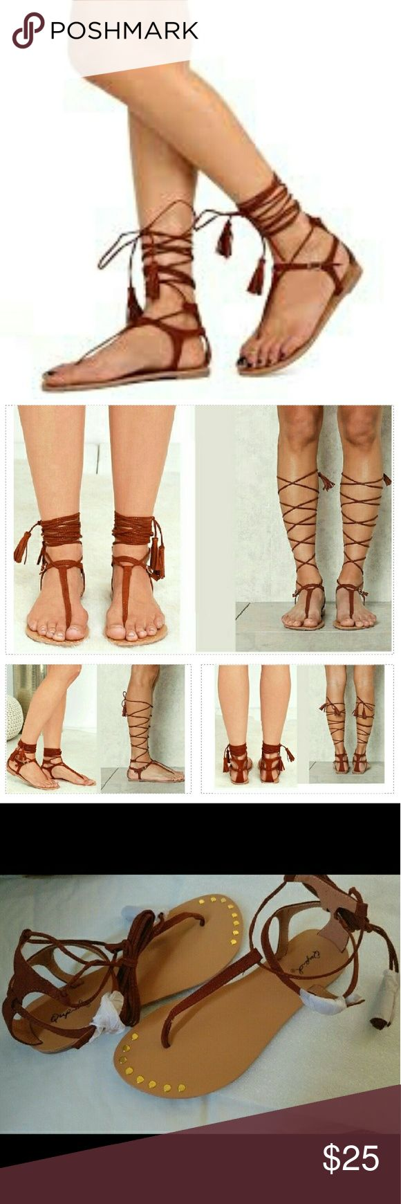 Qupid Lace Up Sandals - whiskey PRICE IS FIRM. NO TRADES. 10% bundle discount.  Lace them at ankle or go all the way up! Chic & minimal thin thong strap with lace up,  tassled-end ties, meets a gold buckling ankle strap. Rounded gold studs along the toes. Man made Suede.  Brand new in box.  Brand: Qupid Color: Whiskey Brown *     M @AngieMarie504 Qupid flat sandals gladiator sandals thong sandals lace up sandals Qupid Shoes Sandals