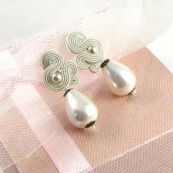 Check out this item in my Etsy shop https://www.etsy.com/listing/210028086/ivory-pearls-wedding-earrings-dangle
