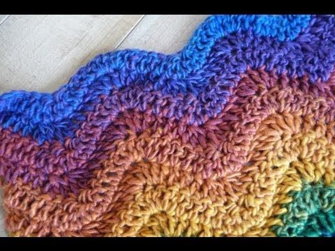 This tutorial teaches you the fundamentals of learning the Wave Stitch Technique. Use this tutorial to create waves for Scarves and virtually any size afghan. I teach you what to look for and how to monitor the sizing you need. This could be considered a Chevron, Ripple or Zig Zag Crochet Pattern. Here is the written pattern, http://thecrochetcr...