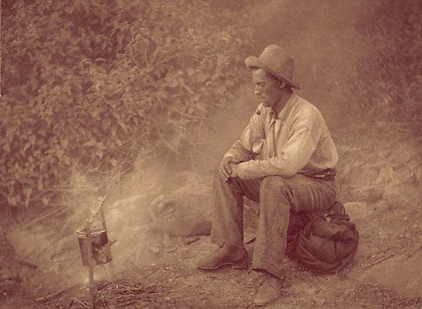 Harold Cazneaux (New Zealand, Australia 1878–1953) While the billy boils Other titles: Billy meditation 1908 carbon photograph, red tone