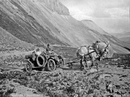 Image of the first automobile arriving to the San Juan Mountains over Stony Pass outside of Silverton, Colorado, on August 27, 1910. The car is a Croxton-Keeton touring car, and the 'stunt' was planned by Louis G. Wyman, Sr., owner of Silverton's Wyman Hotel and a San Juan County, Colorado Commissioner at the time. Obviously the car needed a little assistance over the pass. Pictured left to right are Louis W. Wyman, Jr., Eugene Mechling, Louis G. Wyman, Sr., David L. Mechling, and the…
